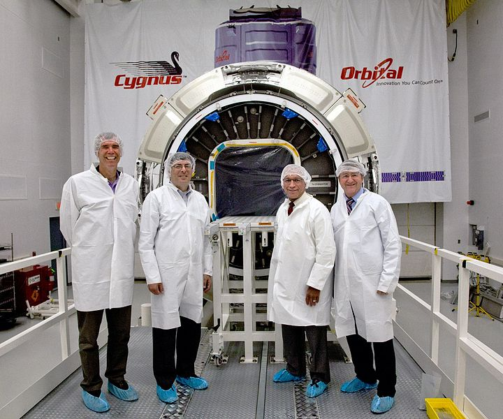 Standing in front of Orbital Sciences Corp. Cygnus cargo carrier are (left to right) Bill Wrobel, Director, Wallops Flight Facility; Chris Scolese, Director, Goddard Space Flight Center; Charles Bolden, NASA Administrator; and Frank Culbertson, senior vice president for Human Spaceflight Systems, Orbital Sciences Corp.