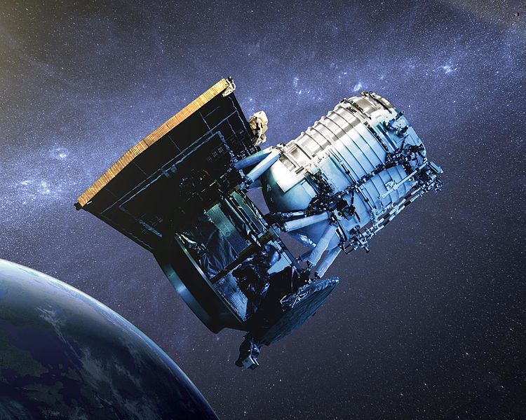 This artist's concept shows the Wide-field Infrared Survey Explorer, or WISE spacecraft, in its orbit around Earth. Credit: NASA/JPL-Caltech