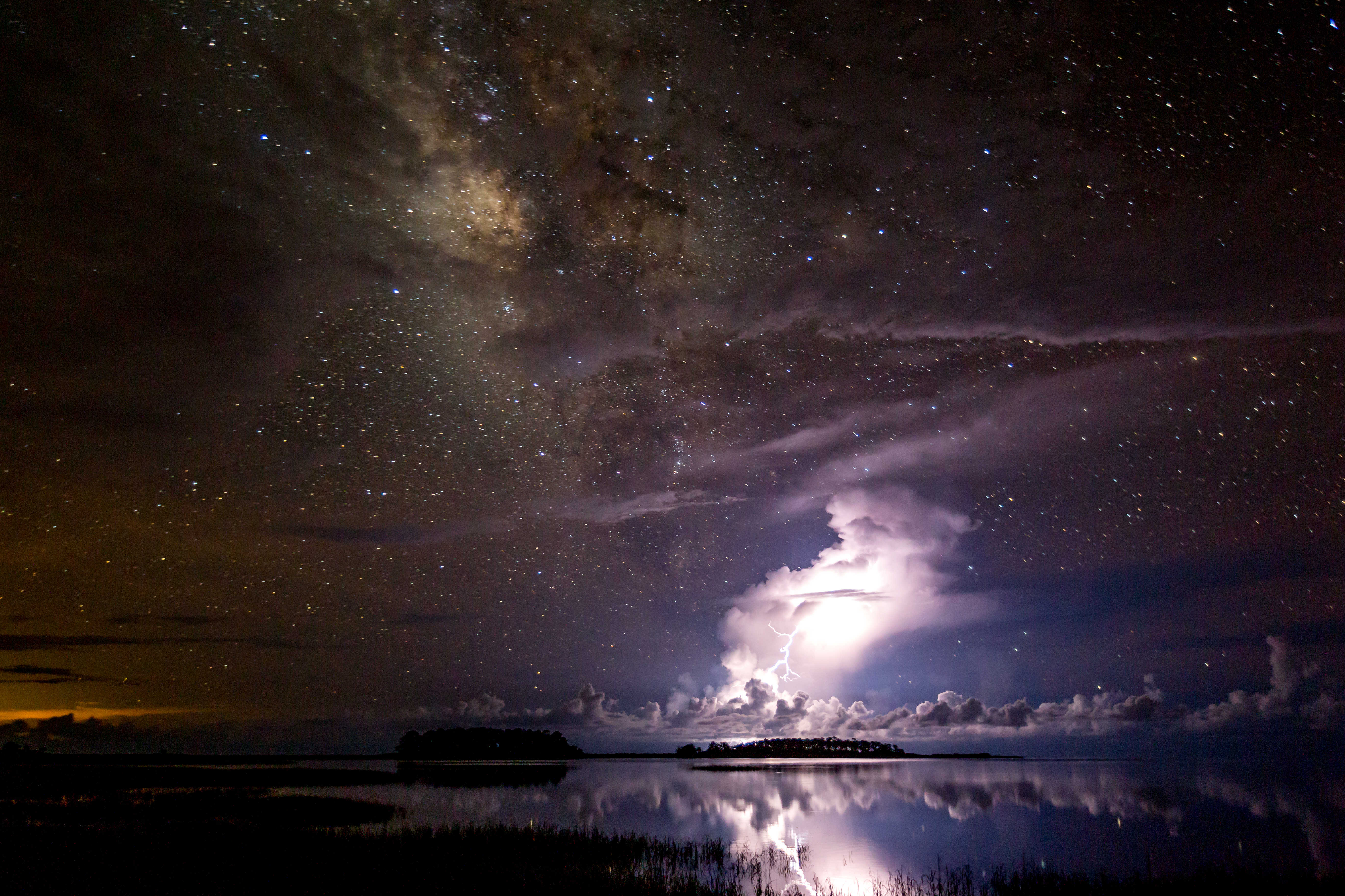 Stars loom over a thunderstorm in Florida.