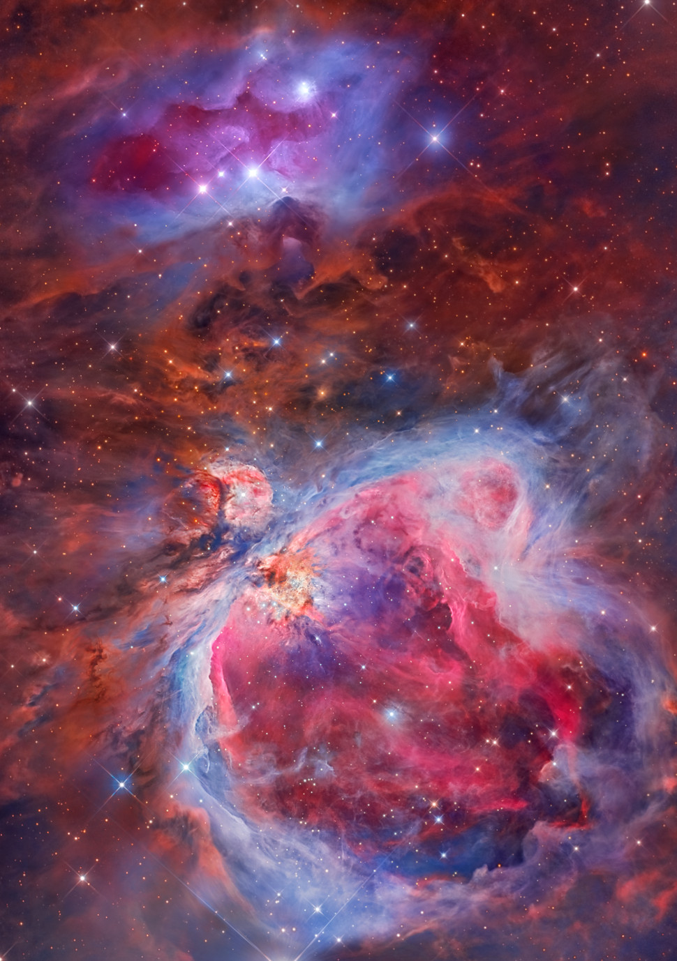 The Orion Nebula (also known as Messier 42, M42, or NGC 1976) is a diffuse nebula situated in the Milky Way, south of Orion's Belt in the constellation of Orion. Located 1,270 light-years away, it's one of the brightest nebulae (a star-forming region) in the night sky, and is visible with the naked eye on a clear night.
