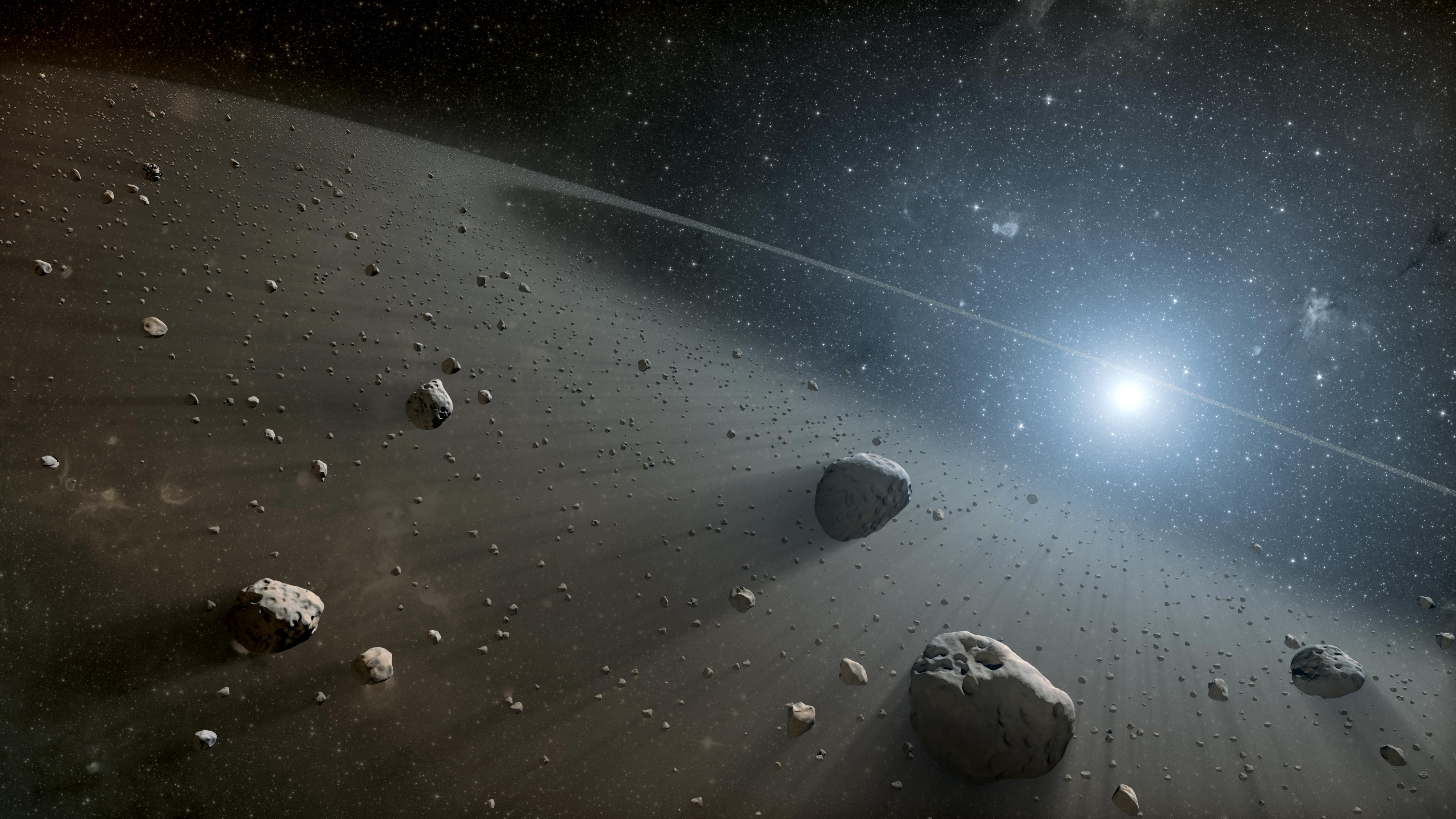 Artist's concept illustrates an asteroid belt around the bright star Vega. Image credit: NASA/JPL-Caltech