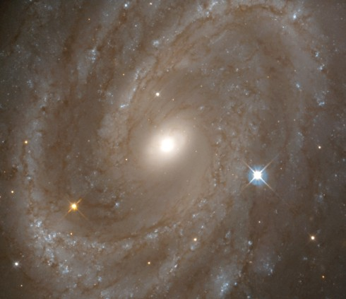NGC 4603, a galaxy with majestic spiral arms and intricate dust lanes, is 108 million light-years away. Credit: NASA