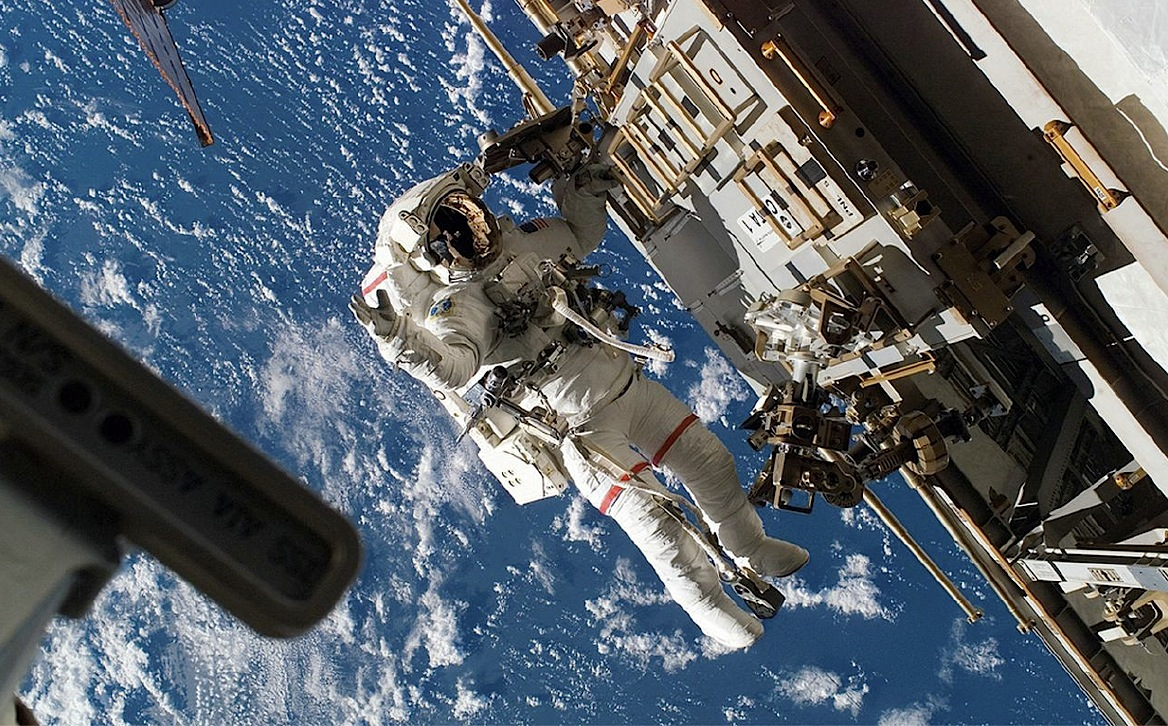 Astronaut working on the International Space Station. Credit: NASA.